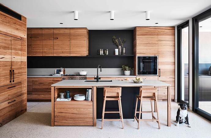 In the heart of the home, a sea of attractive messmate cabinetry reigns supreme in the breathtaking kitchen. The timber barstools were found at Ethnicraft, while the matt black Zip HydroTap is as stylish as it is multi-functional.