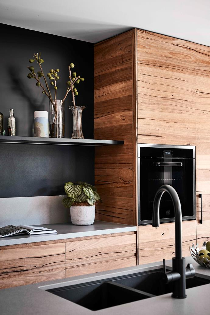 """Juxtaposed against pale grey Dekton Sirocco benchtops, the upper splashback in Dekton Sirius makes a striking statement. """"We wanted to really 'hero' the timber, incorporating a substantial amount of it to provide a warm, homely space and to contrast with the concrete floor,"""" says interior designer Lauren O'Brien of Austin Design Associates."""