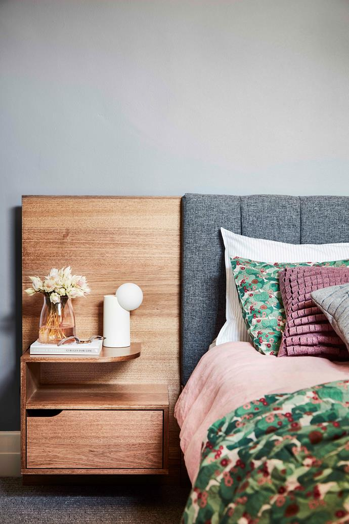 In Sally and Jason's bedroom, the custom 'Lincoln' bed frame by Forty Winks – complete with upholstered bedhead, floating bedside tables and attached backing panel – rightfully claims centrestage. The floating bedside tables and attached backing panel are sold separately.