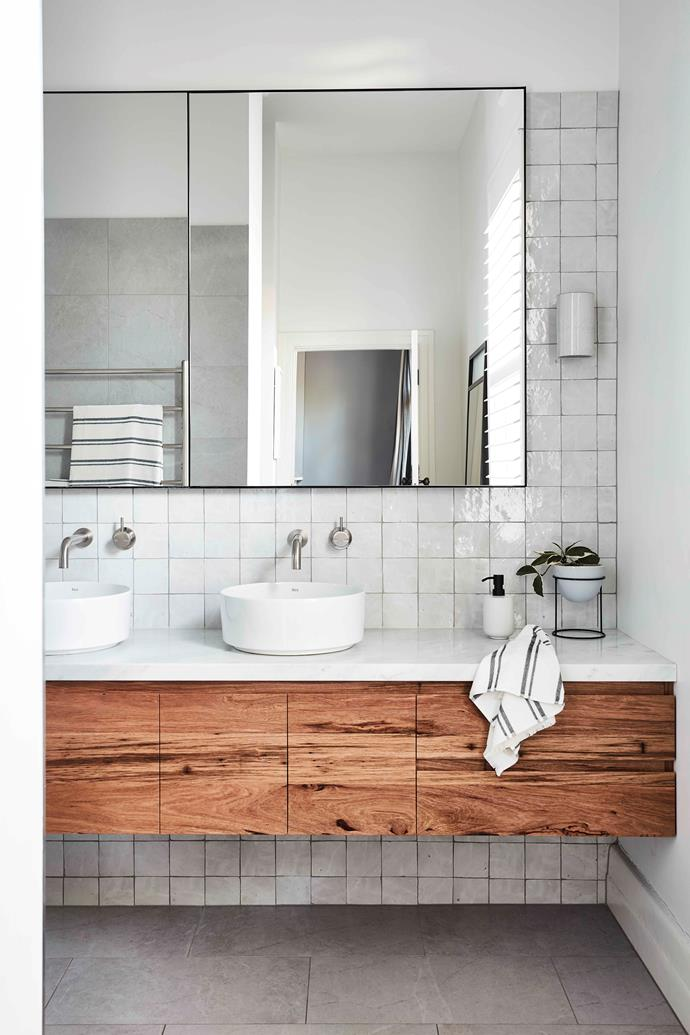 A curvaceous 'I Catini Cielo' washbasin cabinet from Design Precinct in the powder room.