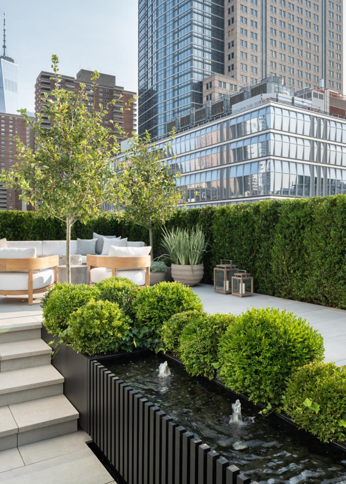 Buxus shrubs ensure the home's interiors, which were designed by Monique Gibson, enjoy a green outlook year-round.