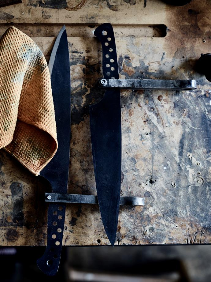 Two chef's knives in different stages of completion.