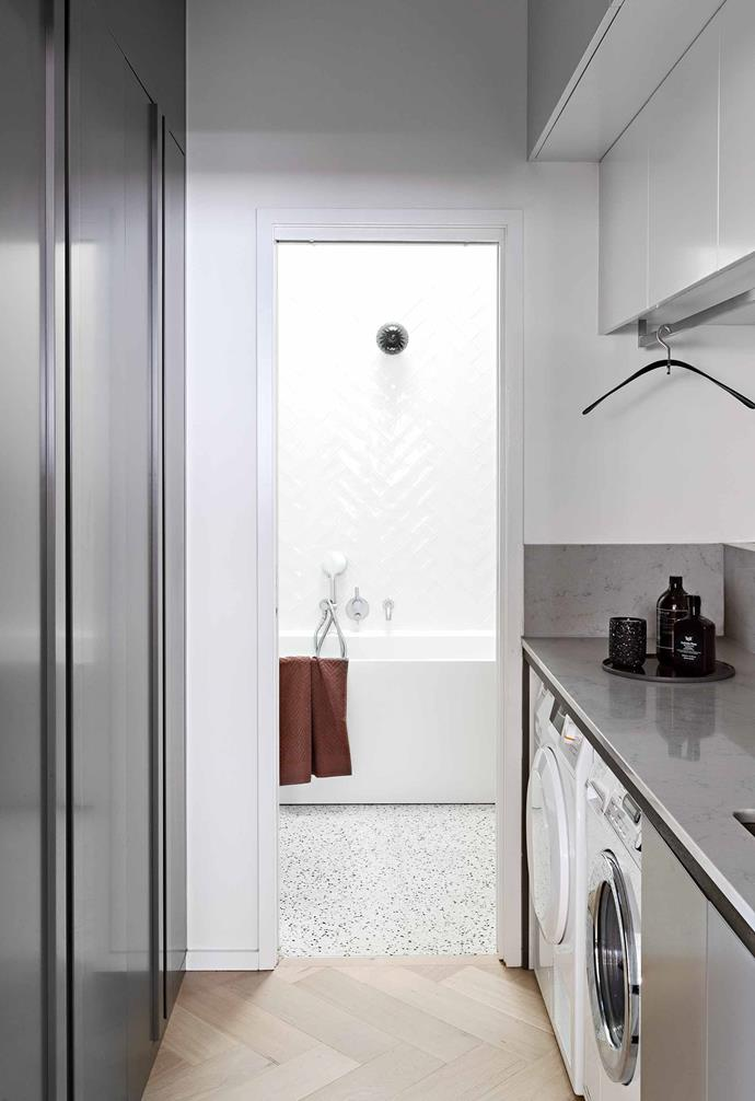 """**Laundry** Häfele Hawa Concepta pivot sliding hardware means the doors in this corridor retract back into the cavity. Appliances, [E&S](https://www.eands.com.au/