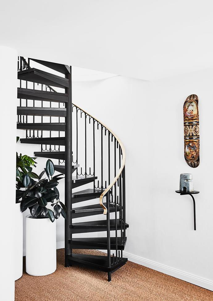 "Sisal flooring at the base of this spiral staircase of this [colourful Sydney penthouse](https://www.homestolove.com.au/colourful-penthouse-apartment-with-personality-20466|target=""_blank"") lets the black iron design become the focal point of the comfortable corner."