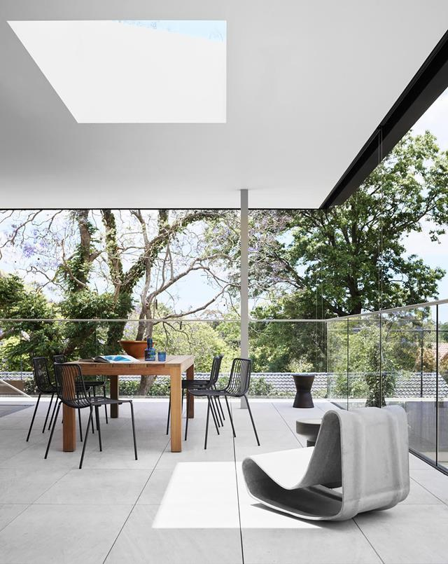 """The dining table is positioned under a giant skylight, ensuring this [contemporary home's](https://www.homestolove.com.au/postwar-bungalow-turned-contemporary-family-home-21021