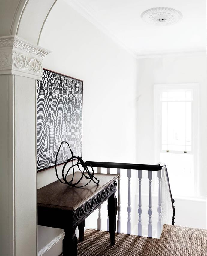 "In the stairway of this [historical Sydney terrace](https://www.homestolove.com.au/luxury-home-tour-historical-sydney-terrace-3559|target=""_blank"") sisal flooring suited its ""restful, neutral palette. There's a lot going on with all the paintings."""