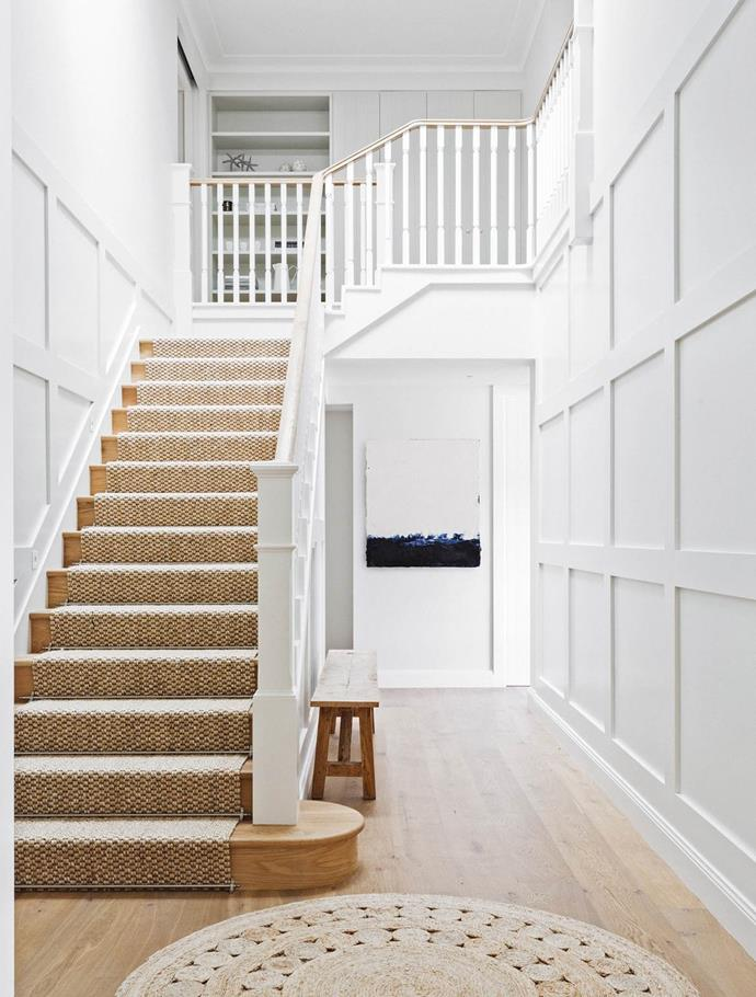 "Sisal carpeting on the stairway of this [luxurious Hamptons-style beach house](https://www.homestolove.com.au/hamptons-style-beach-house-renovation-2380|target=""_blank"") is both practical and perfectly in keeping with its natural surroundings."