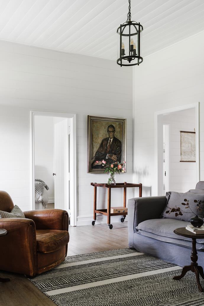 A painting of Angus's grandfather, journalist Jim MacDougall, by Archibald Prize-winner Judy Cassab takes pride of place in the cottage. The antique leather armchair was brought back from London by the couple.