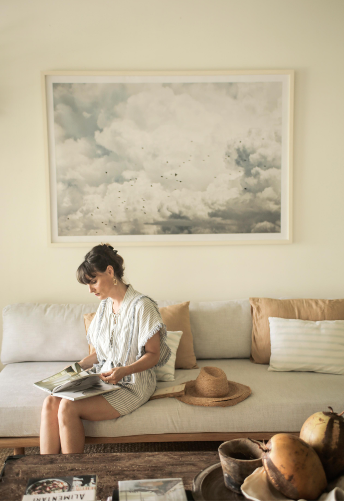 The main artwork is a photograph by her husband Matt – as are most of the artworks around the house – and the lounges are made from recycled teak and French linen.