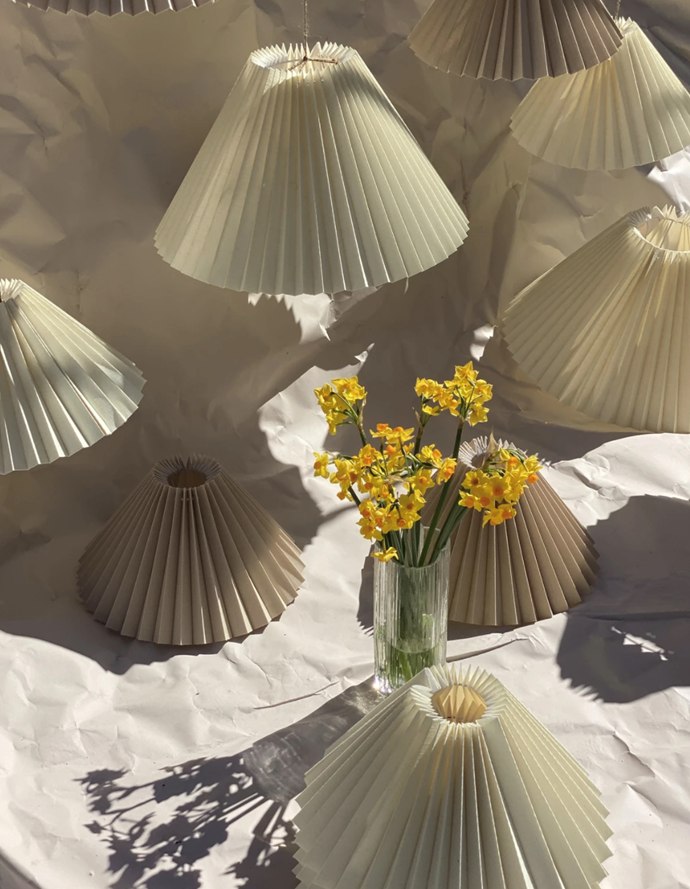 "Pleated Lamp Shades, $85, [Curated Spaces](https://www.curatedspaces.com.au/collections/all-furniture/products/pleated-lamp-shades|target=""_blank""
