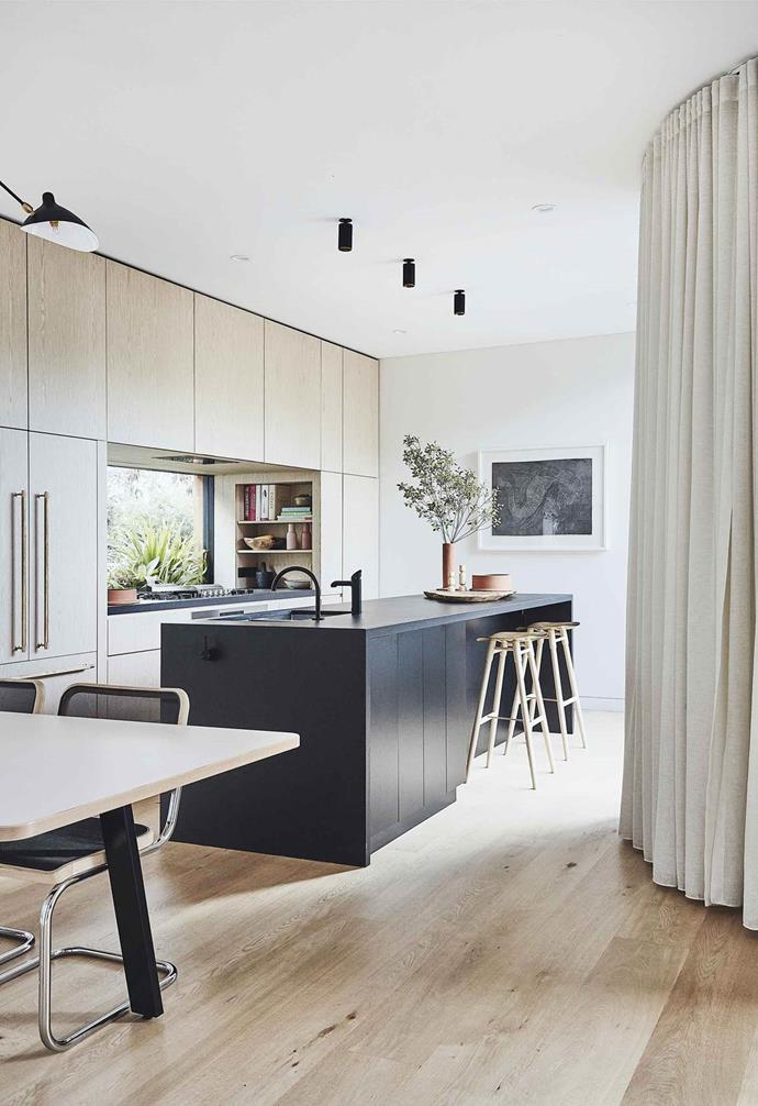 "Opting for a sleek look in the kitchen of this Scandi-noir style [coastal home](https://www.homestolove.com.au/scandi-noir-house-20344|target=""_blank""), a dark Dekton bench top was chosen for its durable qualities. Called 'ultra-compact' surfaces, the Dekton benchtop is designed to be extremely durable and heat-proof."