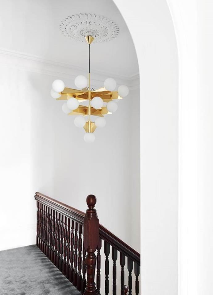 "Interior designer Sonia Attard sought to marry the [Victorian features of this terrace](https://www.homestolove.com.au/a-victorian-terrace-gets-a-contemporary-revamp-6624|target=""_blank"") with newer accents to create fluidity. A gold, Dixon chandelier hangs above the staircase, demonstrating the home's expert fusion of classic meets modern."