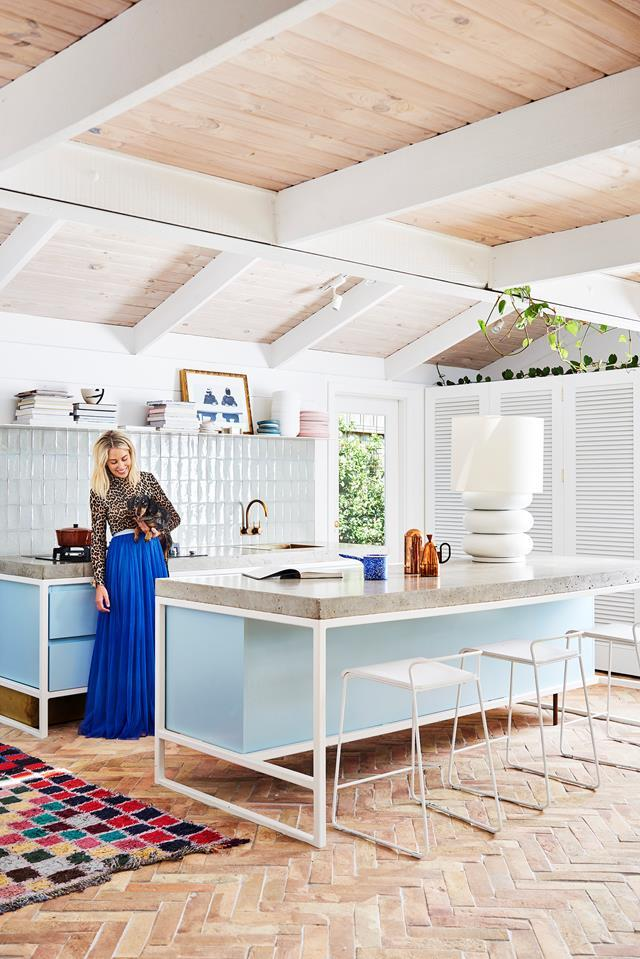 "Artist [Prudence Oliveri's playful kitchen](https://www.homestolove.com.au/prudence-olivieri-home-21346|target=""_blank"") is mid-century modern inspired and features a beautiful pale blue island bench that introduces colour to the space."