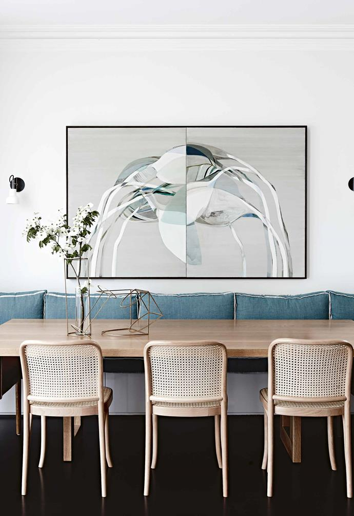 "**Dining room** Gentle shades of turquoise and chocolate add a calming elegance to the dining space. ""We took inspiration from the Emily Ferretti artwork already in the couple's collection,"" says interior designer Chelsea Hing. ""We used a natural timber table for warmth."""