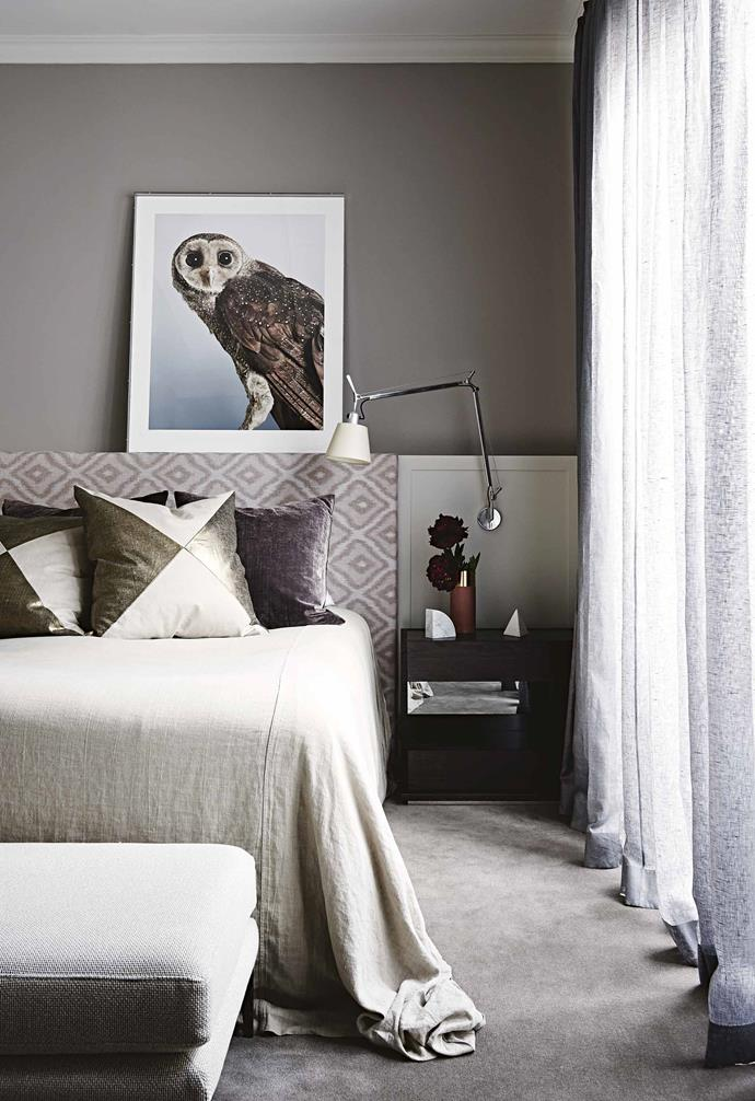 "**Bedroom** The rich blend of texture, colour and pattern envelopes the master bedroom, creating an intimate space. ""The Leila Jeffreys artwork is perfect,"" says Chelsea. ""We created the false ledge with the bedhead and I was waiting for the ideal piece – and we found it!"""
