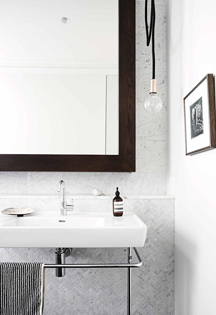 "**Bathroom** ""We also added beautiful details with the marble tiles, using rectangles in the shower and a herringbone pattern on the vanity – it's a decorative touch that adds an extra layer of luxury,"" says Chelsea."
