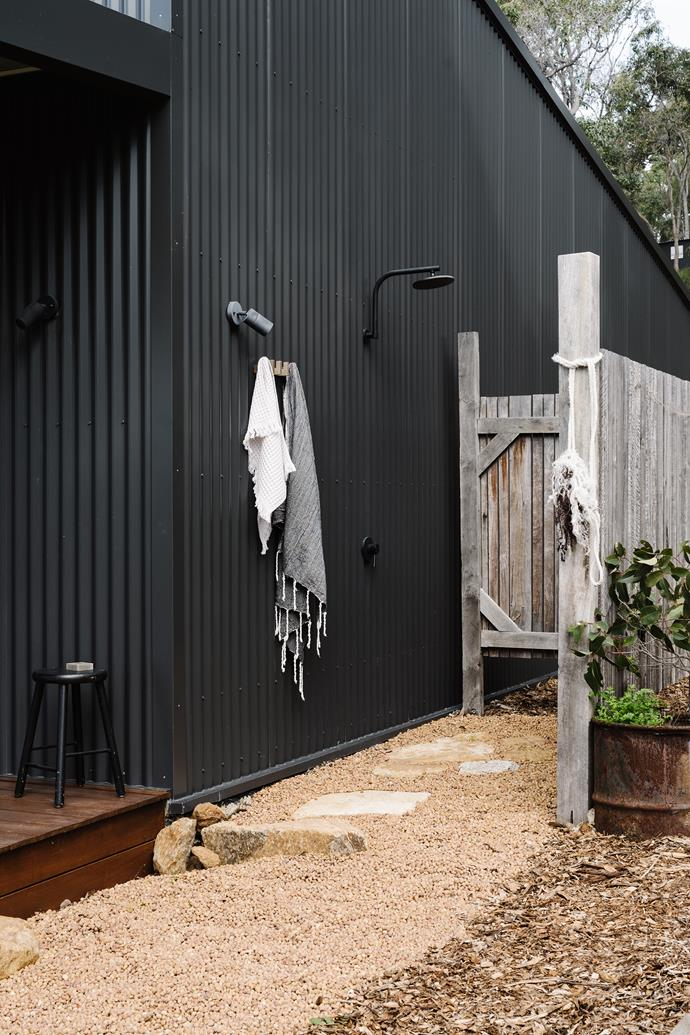 "Dreaming of creating their perfect country holiday retreat, this clever couple built their very own [shed-style home in Western Australia](https://www.homestolove.com.au/colorbond-shed-house-21507|target=""_blank""). Tucked near the deck, the outdoor shower features a black showerhead that complements the dark Colorbond exterior of the home."