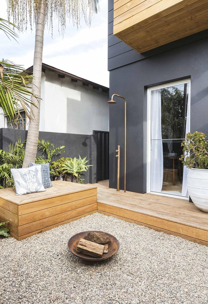"In this [tropical resort-style home](https://www.homestolove.com.au/tropical-resort-style-home-18497|target=""_blank""), the outdoor entertaining zone is packed full of all the amenities an entertainer's house would require. From the cosy fire pit to a sleek and minimalist outdoor shower, the backyard is a place you would never want to leave."