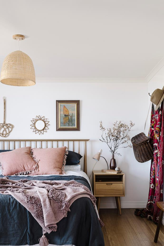 Vintage decor gives the bedroom a cosy, lived-in feel.