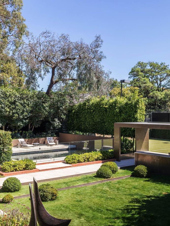 This sculptural garden was designed by Ian Barker. The Crescent Birds bronze sculpture is by Bridget McCrum through Messum's.