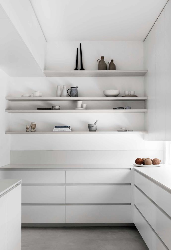 "**Pantry** Like the laundry and [mud room](https://www.homestolove.com.au/mudroom-design-6620|target=""_blank""), this is cleverly hidden behind the kitchen and accessed via pocket doors. Chris refers to these rooms as the ""operations areas"" of the home."