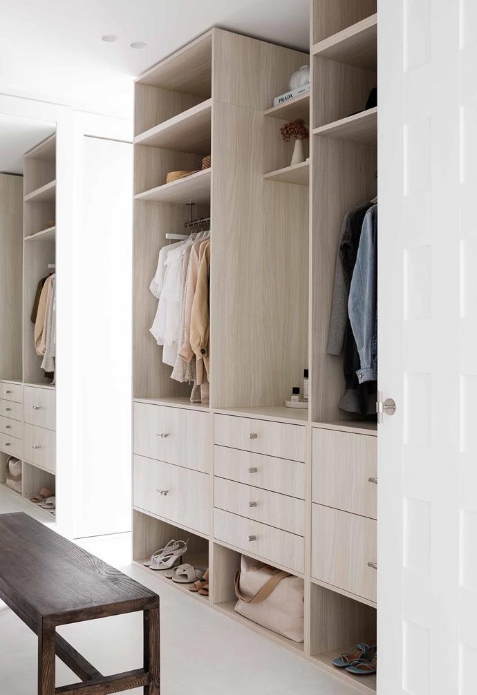 **Master bedroom suite** A generous walk-in wardrobe features ample storage.