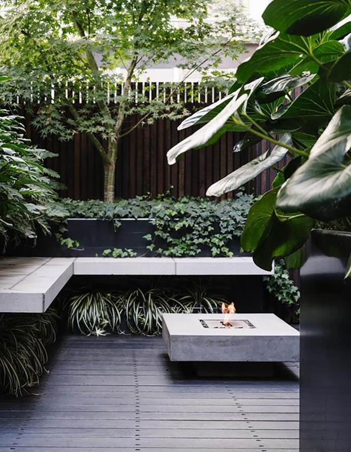 """An outdoor fireplace ensures this [rooftop terrace](https://www.homestolove.com.au/garden-inner-city-terrace-12786