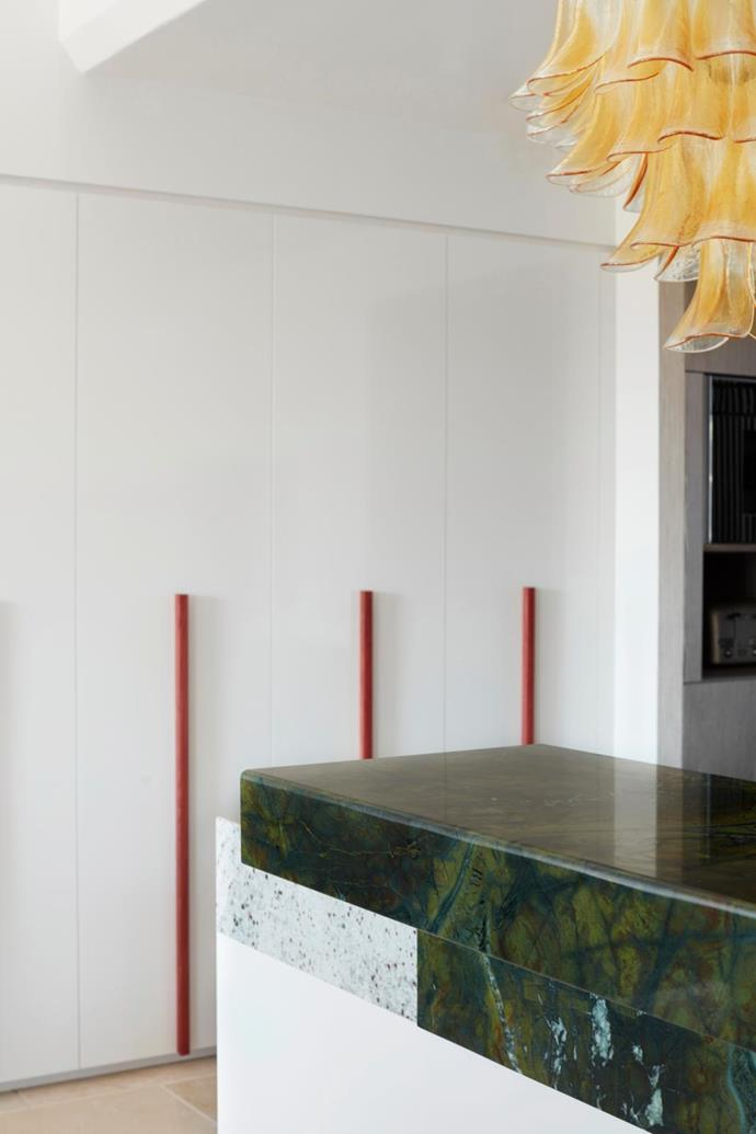 Originally enclosed, a chunky stacked counter in Vitoria Regia marble from Artedomus demarcates the kitchen's boundary.