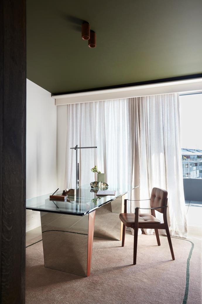 Views over Walsh Bay beckon from the study, formerly a bedroom, from behind filmy S-fold curtains in Mokum 'Satori Stonewash' in Blush made by Simple Studio. De La Espada 'Capo' armchair by Neri&Hu from Spence & Lyda. Dyson 'CSYS' floor lamp from Living Edge. On the desk is a cast-brass tape dispenser by Studio Henry Wilson.