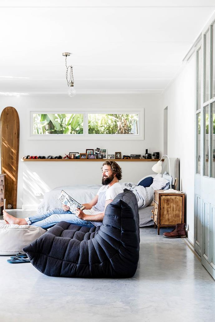 "Jack's space in [this Pittwater home](https://www.homestolove.com.au/pittwater-beach-shack-gets-a-heartfelt-renovation-3064|target=""_blank"") has a navy Togo that looks out over a timber deck towards a bay view. Photo: Maree Homer"