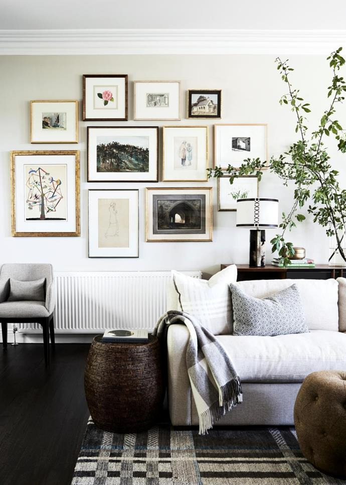 A gallery wall of works by Australian artists creates interest and gives the room narrative. The works were hung by Jonathon Lee of picture hanging service The Hangman.