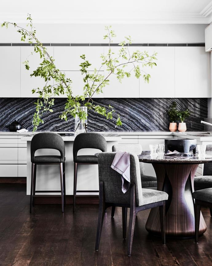 Existing cabinetry and stone splashback. LA barstools and Rene Chyba 'Clara' dining table, all Domo. Dining chairs, Arthur G. Existing spotted-gum flooring.