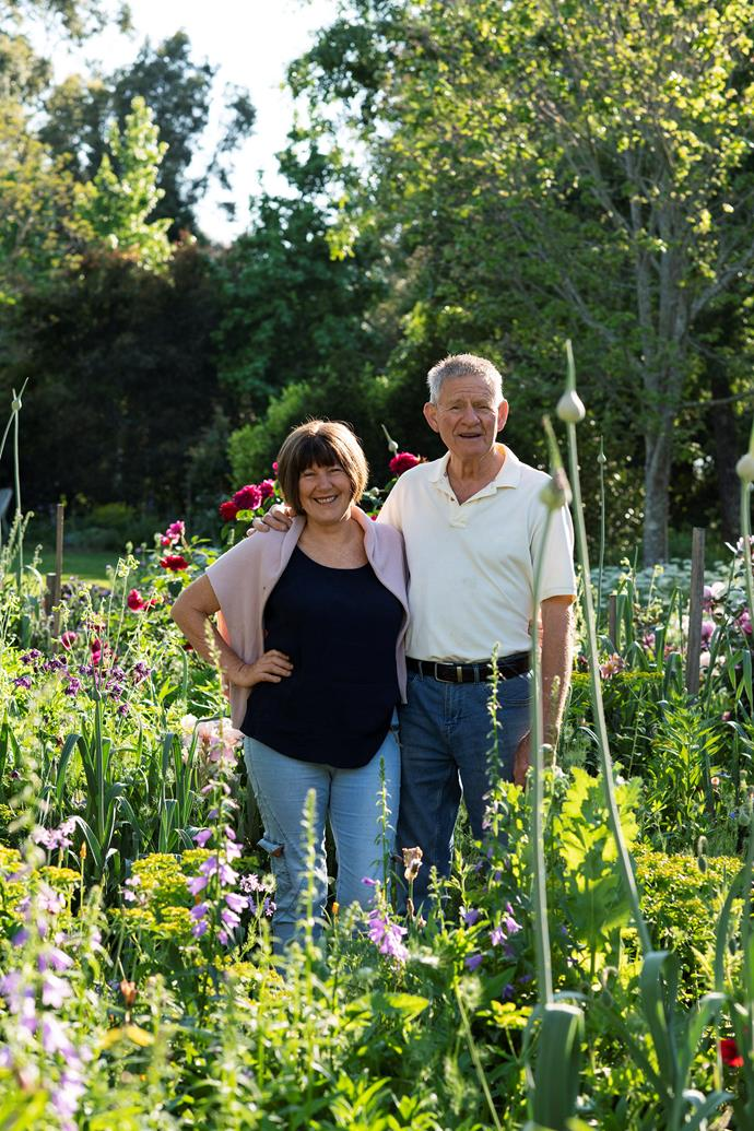 Peter and Grada Shipway among the statuesque leeks and other dramatic  flowering treasures that flourish throughout their garden.