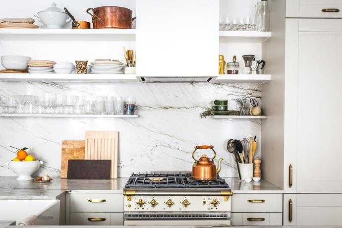 Jackie's kitchen features French brands including Margot tapware and a Lacanche oven. She invested in Mauviel cookware and collected the crystal glasses at Paris flea markets. The cabinets are prefabricated.