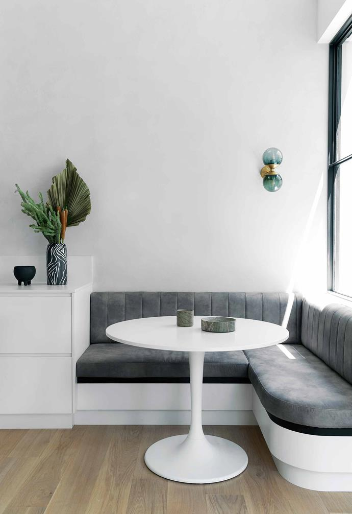 "**Breakfast nook** A sumptuous grey [banquette seat](https://www.homestolove.com.au/banquette-seating-ideas-21101|target=""_blank"") forms a cosy breakfast nook."