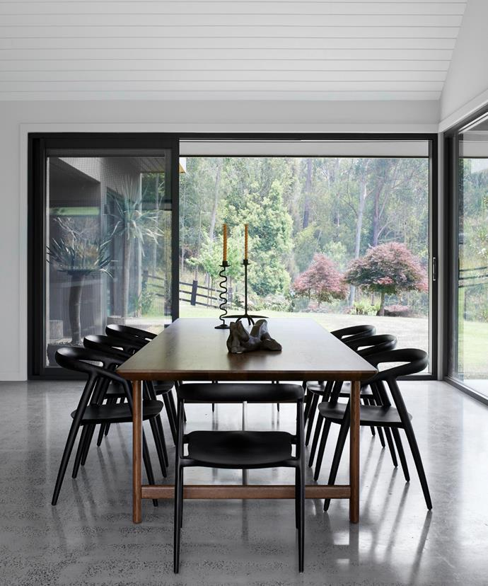 Otway Trestle dining table, Cosh Living. Maki dining chairs, MCM House. Custom candlesticks by Phoebe. Bronze sculpture, The Vault Sydney.
