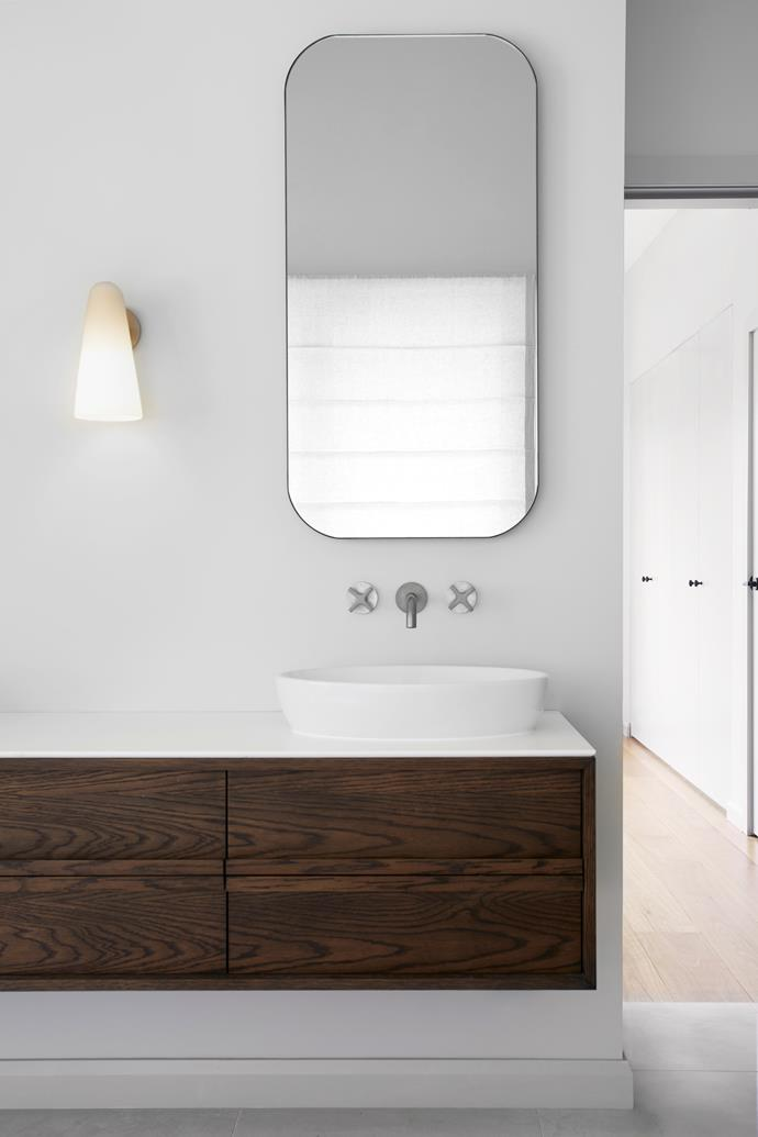 Domi wall sconce, Articolo Lighting. Vanity, mirror, tapware and basin, all Reece.