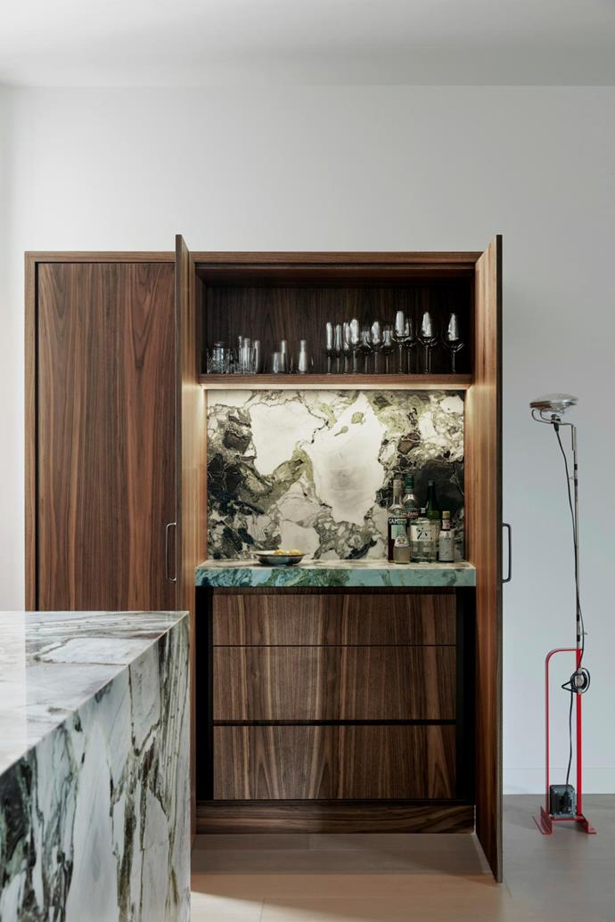 Timber joinery conceals a secret marble bar.