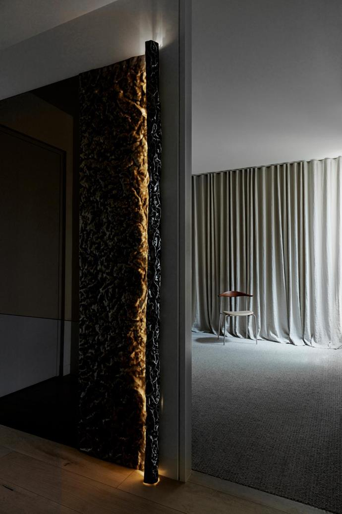 In the entry is a custom textured-metal light installation by Fiona Lynch and Michael Gittings Studio.