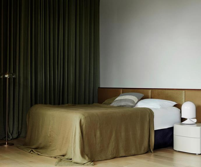 'Verona' leather bedhead from Moss. Pianca 'Doge' side table. 'Vinge' table lamp by Note Design Studio and 'Blossi' floor lamp both from Great Dane.