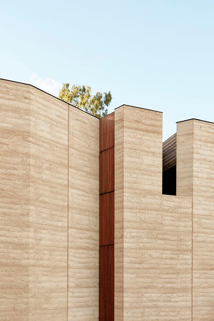 A rammed-earth wall on the south side of the home is a reflection of the nearby sandstone cliffs.