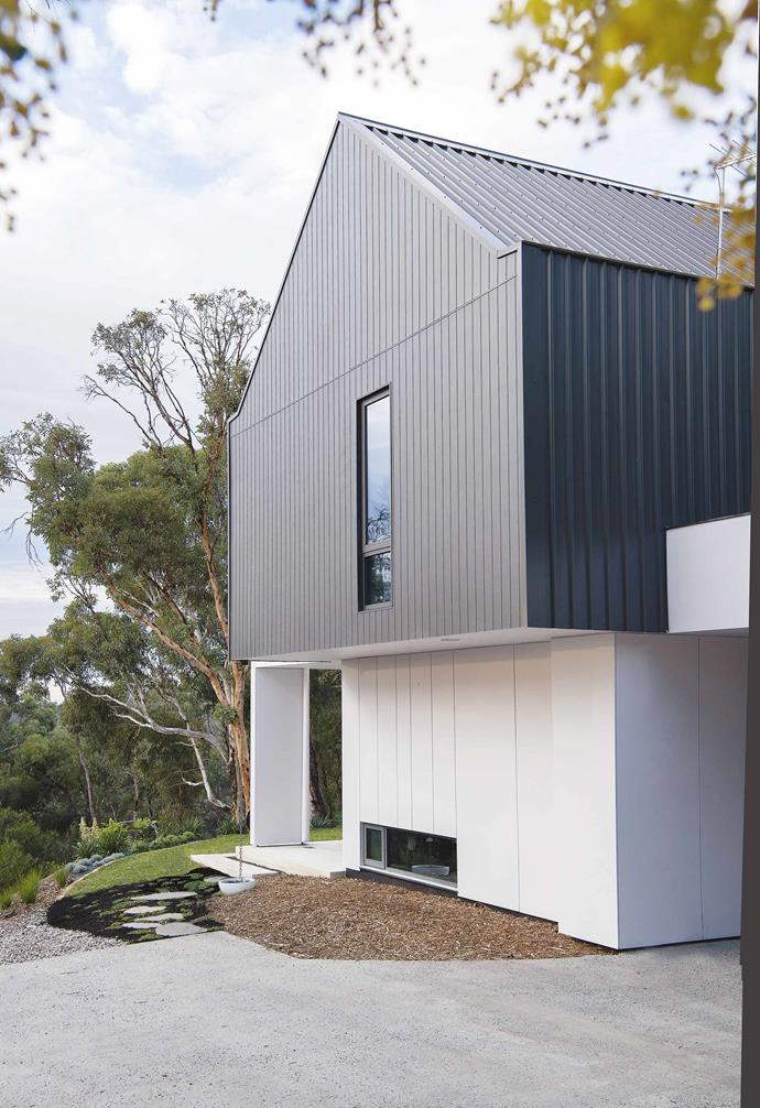 """In the [creation of their dream family home](https://www.homestolove.com.au/barn-style-house-19831 target=""""_blank""""), this clever couple drew inspiration from the classic European barn. With a sleek and contemporary exterior, the interior design of the house features warm tones and pared-back styling."""