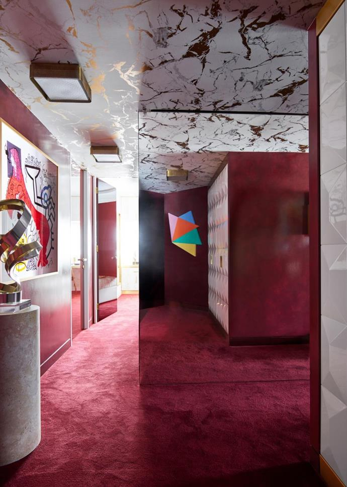 A sculpture by US artist Dan Murphy sits on a custom travertine plinth next to a work by Keith Haring. A Sydney Ball abstraction is reflected in the facing mirrored wall.