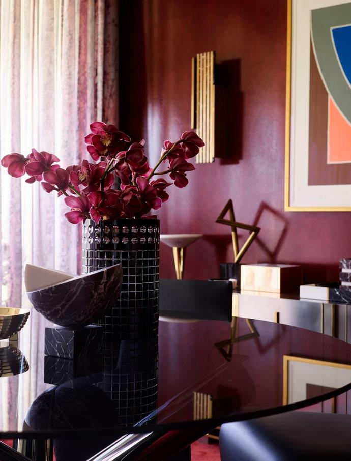 Marble Fleur sculpture and brass 'Ziggurat' bowl, both by Greg Natale, on a Minotti 'Van Dyck' dining table.