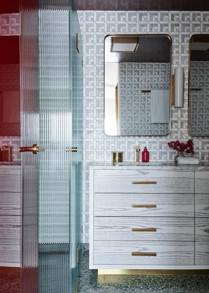 Bathroom walls covered in 'Ponti' tiles by Greg Natale with custom joinery and a green terrazzo slab on the floor. Hand soap from Hôtel Costes.