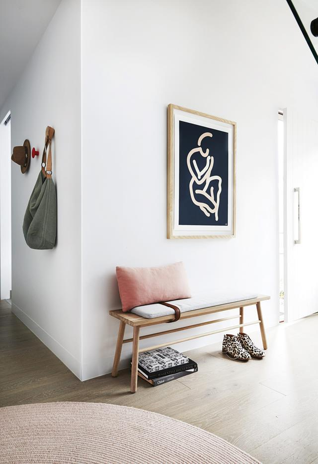 "The [colour of the laminate floorboards](https://www.homestolove.com.au/timber-flooring-colours-18608|target=""_blank"") in this [coastal townhouse](https://www.homestolove.com.au/coastal-holiday-home-19311