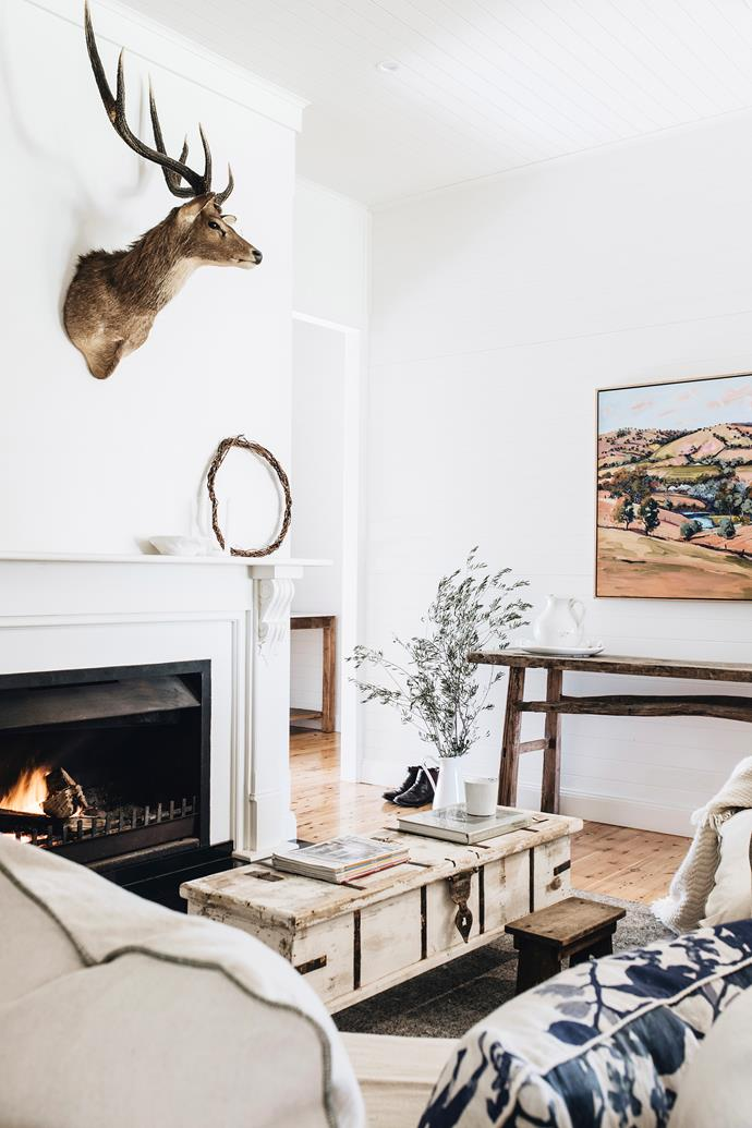 """""""I have an eclectic decorating style, it needs to be functional but I do love pieces with a story,"""" says Jane. Case in point, the painting Boydells View by Polly Kimmorley in the living area. The floral cushions are from Bonnie and Neil."""