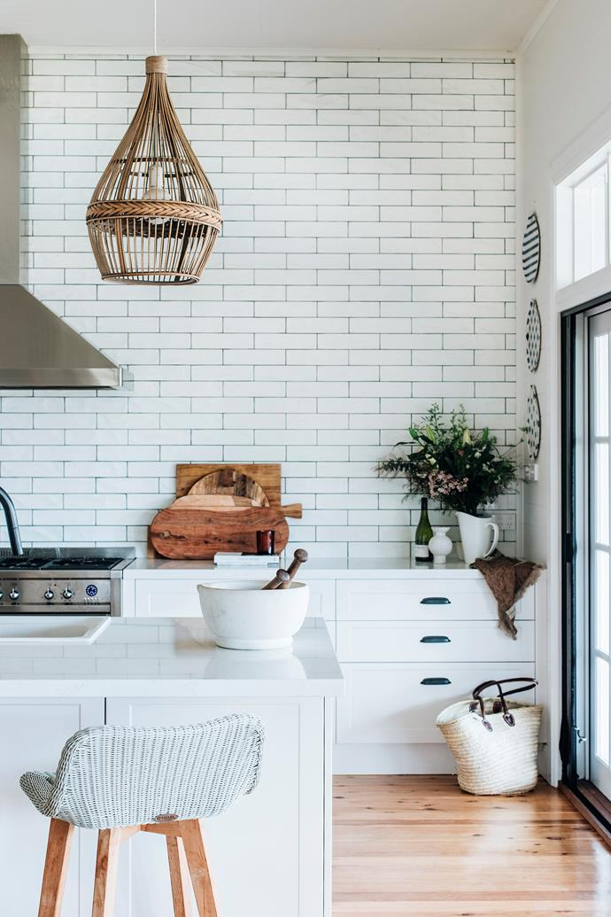 The kitchen is the focal point of the Maroulises' home. Stool from Satara.