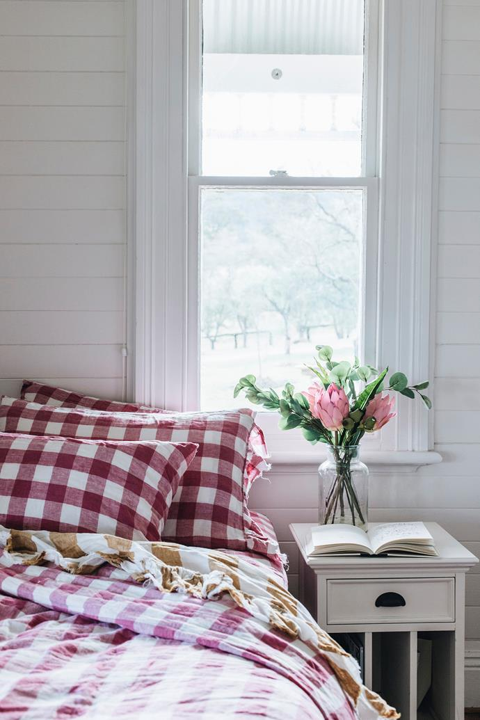 The chequered bed linen in Maggie's room is from Society of Wanderers.