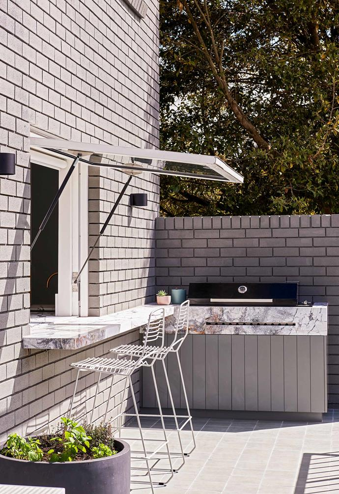 "**Outdoors** A new kitchenette and rumpus area downstairs offer an improved connection with the outdoor entertaining deck and pool, helped by the addition of a [gas strut window](https://www.homestolove.com.au/kitchen-servery-windows-21477|target=""_blank"") that opens out to the marble-clad barbecue area."